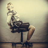 Businesswoman bound by contract with taped mouth. Royalty Free Stock Photo
