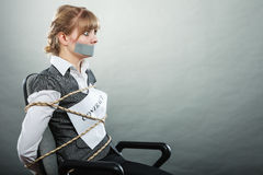 Businesswoman bound by contract with taped mouth. Royalty Free Stock Images