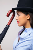 Businesswoman in bowler hat with umbrella. Stock Photo