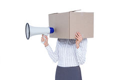 Businesswoman with box over head and holding a megaphone Royalty Free Stock Photos