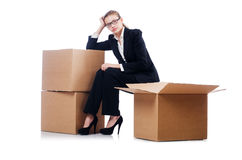Businesswoman with boxes Stock Photo