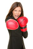 Businesswoman boxing. Business woman boxing punching towards camera ready to fight. Strength, power or competition concept image of beautiful strong Asian / Royalty Free Stock Image
