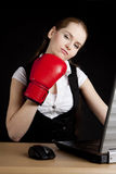 Businesswoman with a boxing glove Royalty Free Stock Photography