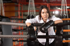 Businesswoman with boxing glove,Tiredness. Stock Photography