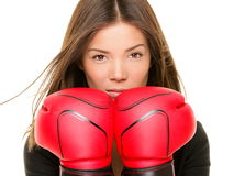 Businesswoman boxing gloves. Businesswoman wearing boxing gloves ready to fight. Strength, power or competition concept image of beautiful young mixed race Stock Photos