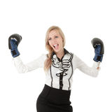 Businesswoman with boxing gloves Stock Photos