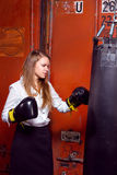 Businesswoman with boxing gloves Royalty Free Stock Photo