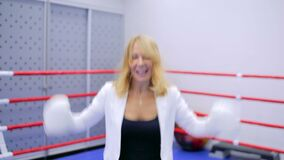 Businesswoman in boxing gloves stock footage