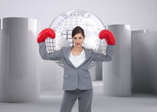 Businesswoman with boxing gloves Royalty Free Stock Photos