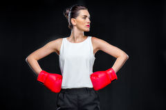 Businesswoman in boxing gloves Royalty Free Stock Photography