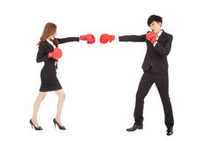 Businesswoman with boxing gloves having a fight with man Royalty Free Stock Images