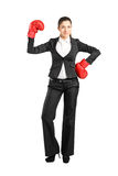 Businesswoman with boxing gloves posing Royalty Free Stock Photography