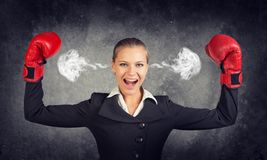 Businesswoman in boxing gloves posing with her Royalty Free Stock Photo