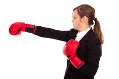 Businesswoman with boxing gloves punching and hitting standing i Royalty Free Stock Images