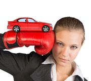 Businesswoman in boxing gloves Stock Images