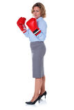 Businesswoman in boxing gloves side view Stock Images