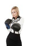 Businesswoman in boxing mitten Stock Image