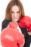 Businesswoman boxing punching towards and ready to fight Stock Photo