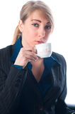 The businesswoman on a break drinks coffee Royalty Free Stock Photography