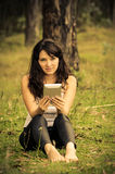 Businesswoman on break in park with a tablet Stock Photo