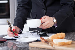 Businesswoman during the breakfast Royalty Free Stock Photo