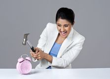 Businesswoman breaking alarm clock Royalty Free Stock Images