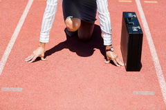 Businesswoman with briefcase in ready to run position Royalty Free Stock Photo