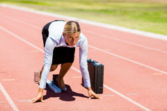 Businesswoman with briefcase ready to run Royalty Free Stock Photography