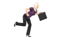Businesswoman with briefcase running Royalty Free Stock Photos