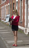 Businesswoman with briefcase on a street Stock Photo