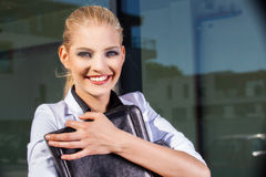 Businesswoman with briefcase in an urban setting Royalty Free Stock Images
