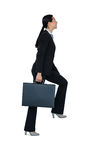 Businesswoman with briefcase walking on stairs Royalty Free Stock Photo
