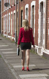 Businesswoman with briefcase walking on a street Stock Photo