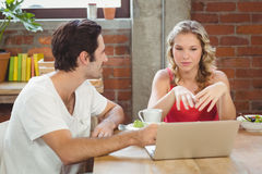 Businesswoman briefing colleague in office Royalty Free Stock Photography