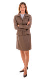 Businesswoman in brown suit is standingand  crossing arm on whit Stock Images