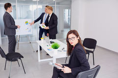Businesswoman brunette in glasses on background business people Royalty Free Stock Photo