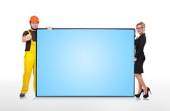 Businesswoman and builder Stock Photos