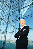 Businesswoman by building Stock Image