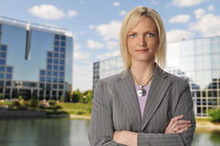Businesswoman with buildings on the background Stock Photo