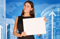 Businesswoman with buildings and world map Stock Photos