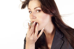 Businesswoman with a bulb in her mouth Royalty Free Stock Photos