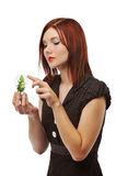 Businesswoman with bulb and tree Stock Images