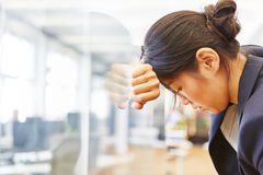 Businesswoman with burnout in the office. Tired and depressed Stock Photos