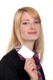 Businesswoman with a business card Royalty Free Stock Images