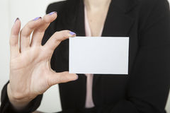 Businesswoman with business card Royalty Free Stock Image