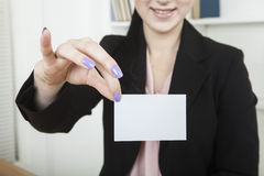 Businesswoman with business card Stock Photography