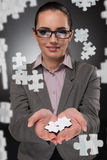 The businesswoman in business concept with puzzle piece Royalty Free Stock Image