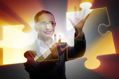 The businesswoman in business concept with puzzle piece Stock Photos