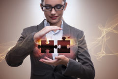 The businesswoman in business concept with puzzle piece Stock Image