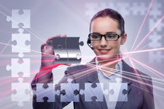 The businesswoman in business concept with puzzle piece Stock Photo